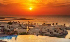 Pool and Brach access the Cove Rotana Resort