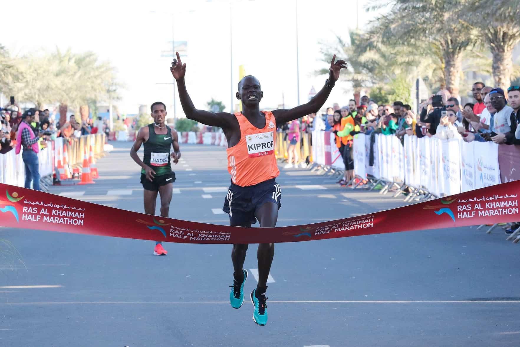 Kiprop_StephenElite male category winner crossing finish line